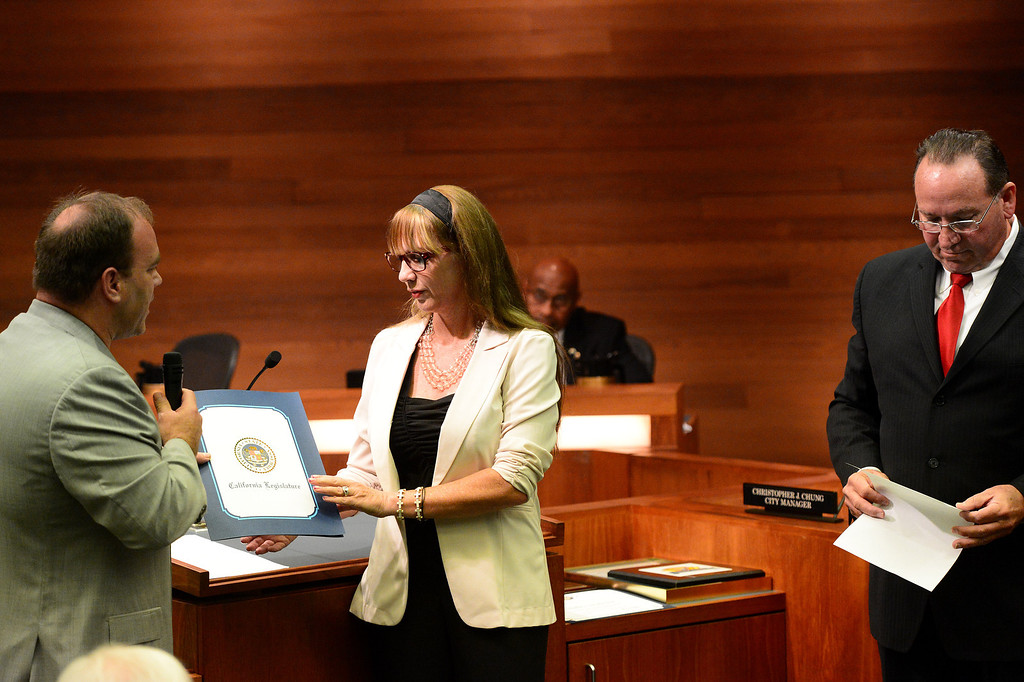 Description of . Mayor Shelley Sanderson receives honors as she leaves the West Covina City Council before three new council members were sworn in Tuesday night, December 3, 2013 in the city's council chambers. (Photo by Sarah Reingewirtz/Pasadena Star-News)