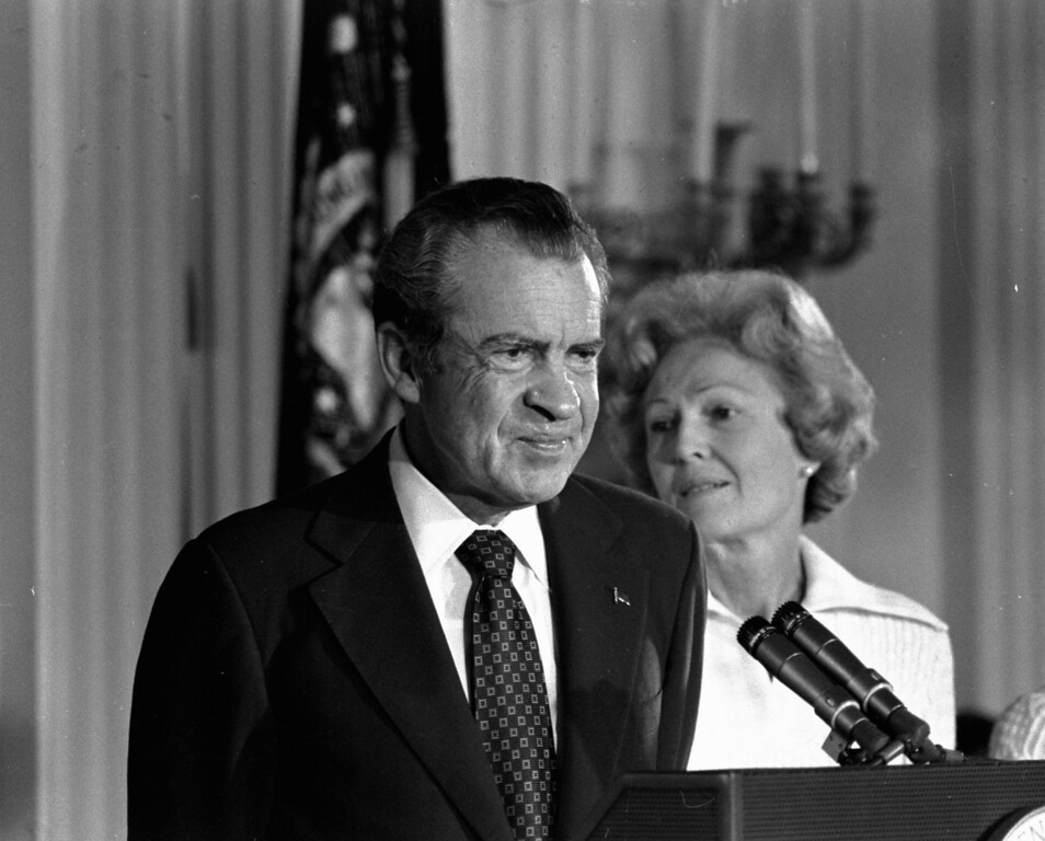 Description of . In this Aug. 9, 1974 black-and-white file photo, President Richard M. Nixon and his wife Pat Nixon are shown standing together in the East Room of the White House in Washington. Thirty-six years after Nixon testified secretly to a grand jury investigating Watergate, a federal judge orders the first public release of the transcript. (AP Photo/Charlie Harrity, File)