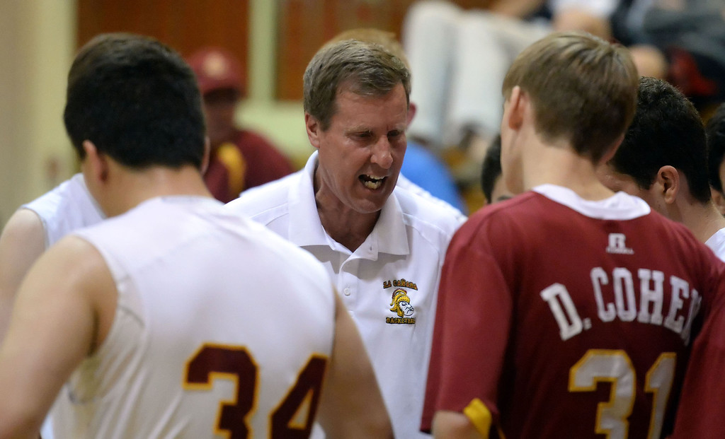 Description of . La Canada head coach Tom Hofman during a time-out in the second half as they defeated La Salle 73-62 for coach Hofman's 600th win during a prep basketball game at La Canada High School in La Canada, Calif., on Friday, Jan. 10, 2014. Hofman record is 600 wins and 186 losses since becoming varsity head coach in the 1986-87 season. (Keith Birmingham Pasadena Star-News)