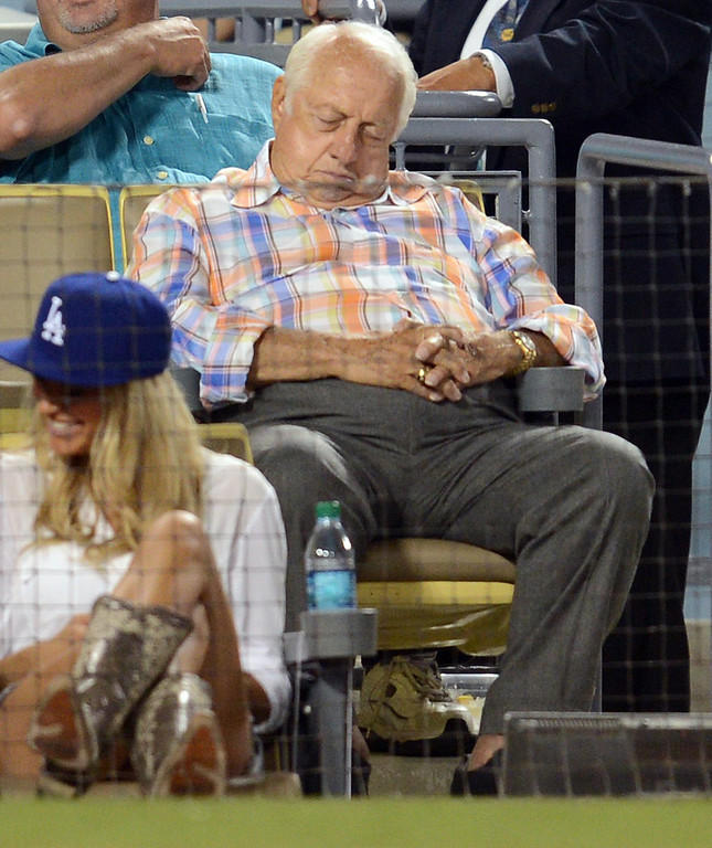 Description of . Former Dodger manager Tommy Lasorda  appears to be napping in the 7th inning while the Dodgers trail the Giants14-3 during their game at Dodgers Stadium Saturday, September 14, 2013. (Photo by Hans Gutknecht/Los Angeles Daily News)