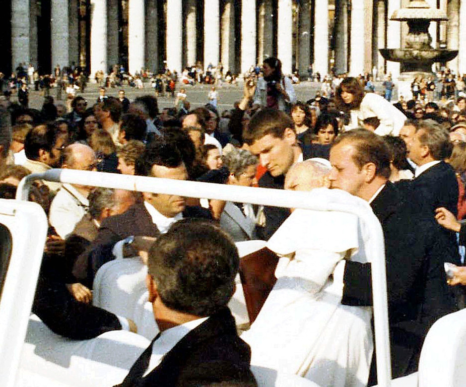 Description of . Alois Estermann, on the left of Pope John Paul II, helps the wounded Pontiff seconds after he was shot in St. Peter's Square at the Vatican in this May 13, 1981  photo. Col. Estermann, 43, his Venezuelan wife Gladys Meza Romero and Cedrich Tornay, 23, a non-commissioned officer of the elite corps were found shot to death in Estermann's apartment inside the Vatican Monday night, just 12 hours after he was nominated commander of the Swiss Guards by Pope John Paul II. (AP Photo/Arturo Mari)