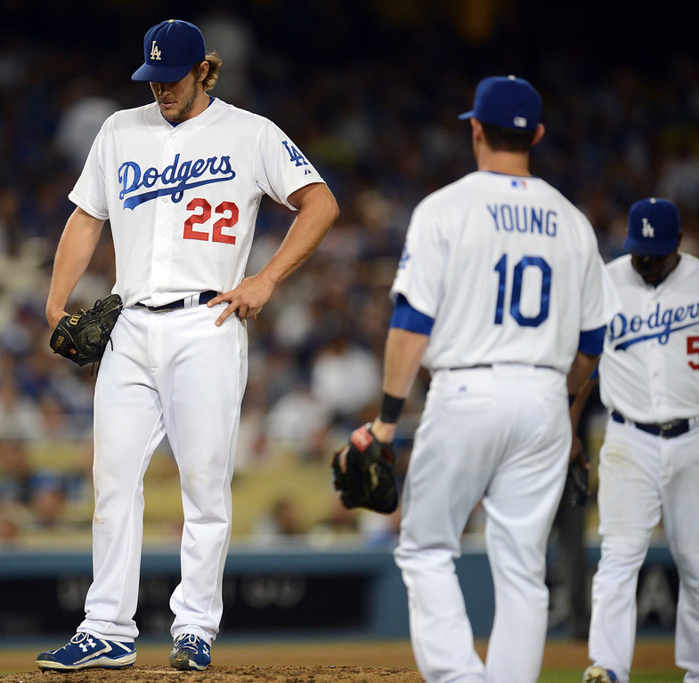 Description of . Dodger pitcher Clayton Kershaw #22 hangs his head after giving up 3 runs in the 7th inning during their game against the Giants at Dodgers Stadium Friday, September 13, 2013. Giants won 4-2.  (Photo by Hans Gutknecht/Los Angeles Daily News)