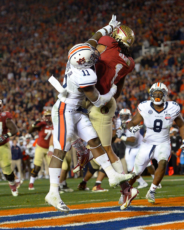 Description of . Florida State's Kelvin Benjamin catches the game-winning pass while being defended by Auburn's Chris Davis during the 2014 Vizio BCS National Championship January 6, 2014 in Pasadena CA.  Florida State won the game 34-31.(Andy Holzman/Los Angeles Daily News)