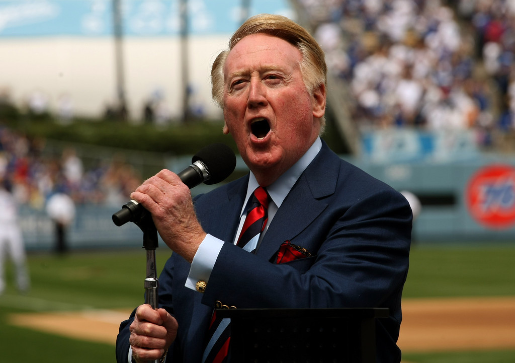 Description of . LOS ANGELES - APRIL 13:  Dodgers broadcaster Vin Skully gives the call of