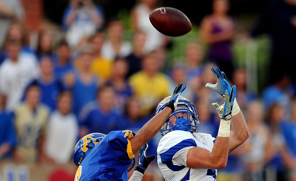 Description of . Santa Margarita's Kyle Sweet catches a pass for a touchdown over Bishop Amat's Anthony Camargo (C) in the first half of a prep football game at Bishop Amat High School on Friday, Aug. 30, 2013 in La Puente, Calif.   (Keith Birmingham/Pasadena Star-News)