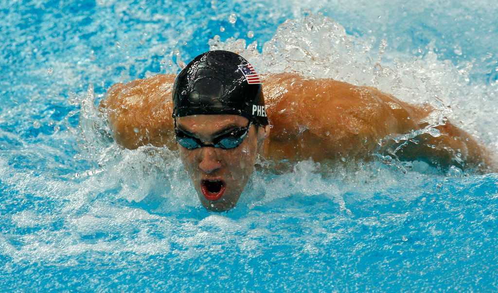 Description of . United States' Michael Phelps swims to the gold in the men's  4x100-meter medley relay final at the Beijing 2008 Olympics in Beijing, Sunday, Aug 17, 2008. (AP Photo/Luca Bruno)