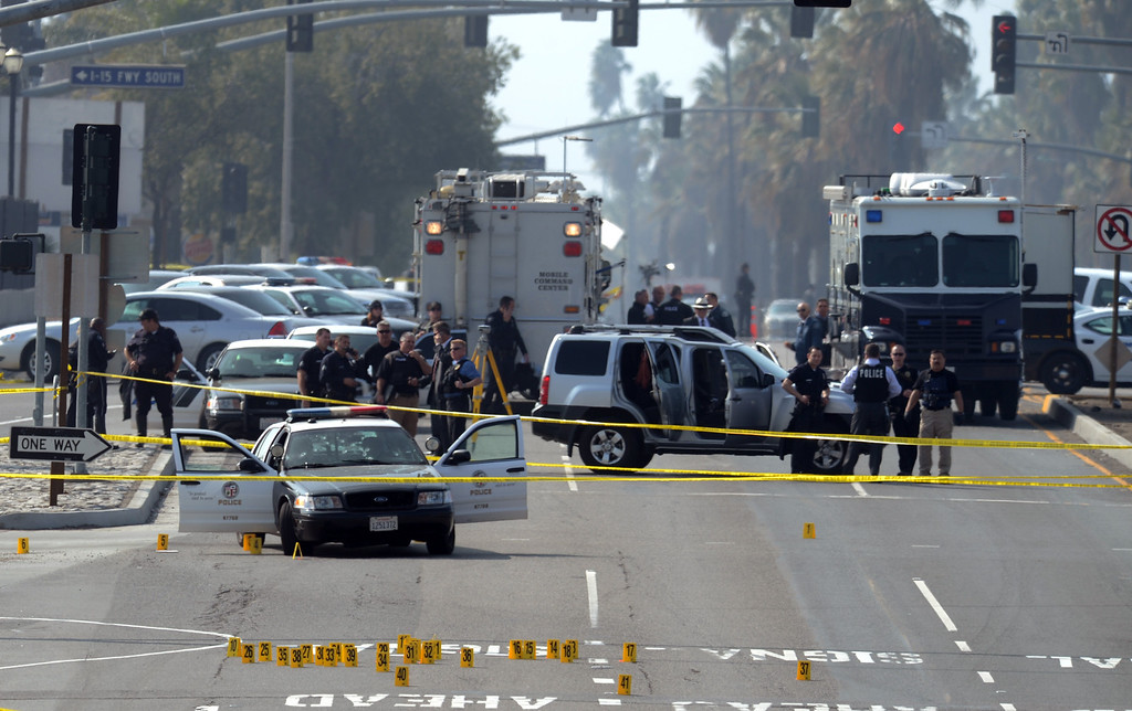 Description of . LAPD investigators work a shooting scene where police officer was shot at by ex-LAPD officer Christopher Jordan Dorner in Corona February 7, 2013. (Staff  photo by Thomas Cordova/Inland Valley Daily Bulletin)