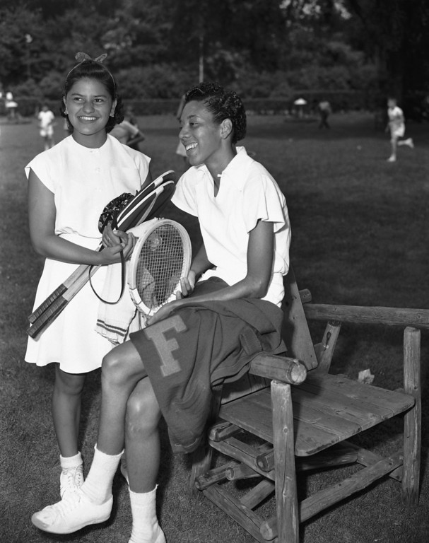 Description of . Althea Gibson, right, tennis player from Florida A&M College, talks with Mela Ramirez of Mexico City, before their match in the opening round of the U.S. Lawn Tennis Association Clay Courts Championship in River Forest, Illinois, July 18, 1950. Gibson defeated Ramirez, the Mexican women\'s tennis champion, 6-3, 6-1. (AP Photo)