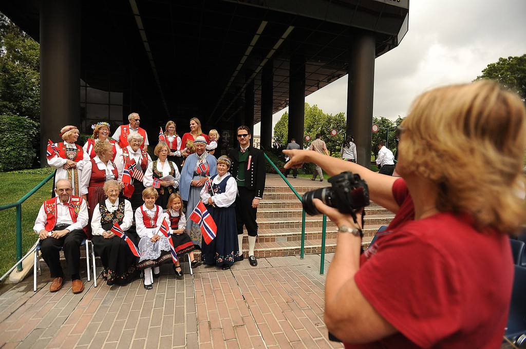 Description of . Members of the Sons of Norway pose for a group photo during a Norway Constitution Day celebration in downtown San Bernardino May 17, 2013.  GABRIEL LUIS ACOSTA/STAFF PHOTOGRAPHER.