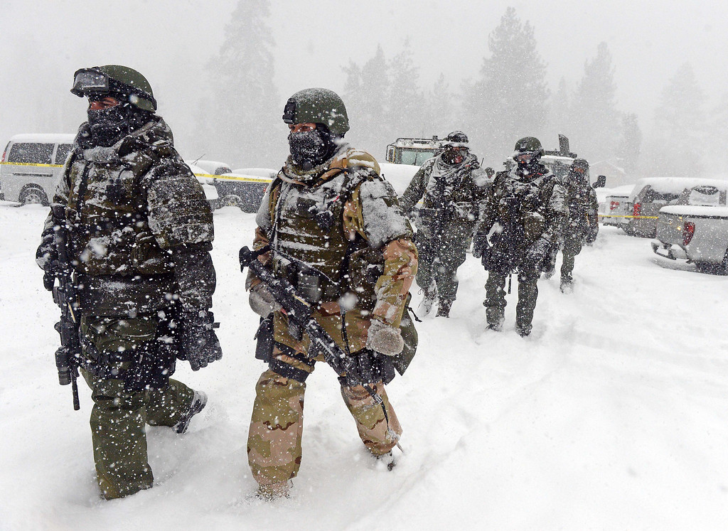 Description of . A San Bernardino County Sheriff SWAT team returns to the command post at Bear Mountain in Big Bear after searching for Christopher Jordan Dorner Friday February 8, 2013. Search conditions have been hampered as a heavy winter storm has hit the area. (Staff photo by Will Lester)