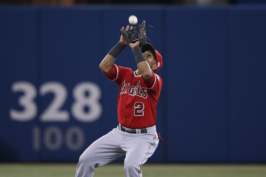 Description of . TORONTO, CANADA - SEPTEMBER 11: Erick Aybar #2 of the Los Angeles Angels of Anaheim catches a pop up in the ninth inning during MLB game action against the Toronto Blue Jays on September 11, 2013 at Rogers Centre in Toronto, Ontario, Canada. (Photo by Tom Szczerbowski/Getty Images)