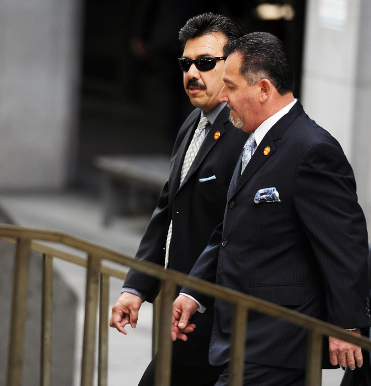 Description of . Irwindale Councilman, Manuel Garcia, left, and  Mayor Mark Breceda, leaving Clara Shortridge Foltz Criminal Justice Center. Former Irwindale Councilwoman Rosemary Ramirez,   Councilman, Manuel Garcia,  Mayor Mark Breceda, and Finance Director Abe DeDios were with their attorneys at Clara Shortridge Foltz Criminal Justice Center Thursday, February 27, 2014.  Irwindale officials are accused of misappropriation of public funds, conflict of interest and embezzlement spending $200,000 on trips to New York City between 2001-2005.  Their arraignment was postponed once again to April 9, 2014.(Photo by Walt Mancini/San Gabriel Valley Tribune)