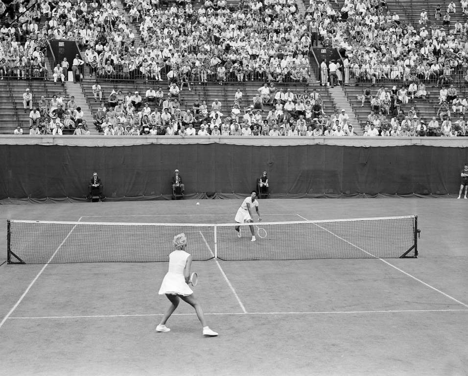 Description of . Wimbledon champion Althea Gibson of New York sends a forehand smash toward Karol Fageros of Miami Beach, for a point during their first round match in the U.S. Tennis Championships at the West Side Tennis Club in Forest Hills, N.Y., Aug. 31, 1957.  (AP Photo/John Lindsay)