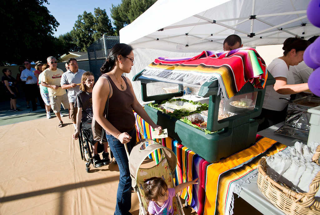 Description of . People wait in line to sample food during Taste of Heights at Carolyn Rosas Park in Rowland Heights on Wednesday, May 30, 2013. (SGVN/Staff photo by Watchara Phomicinda)