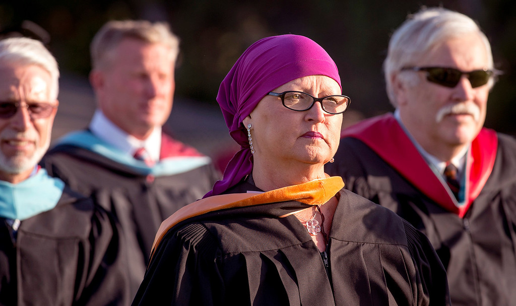 Description of . Principal Claudia Karnoski enters Covina High School graduation at Covina District Field June 10, 2014.   (Staff photo by Leo Jarzomb/San Gabriel Valley Tribune)