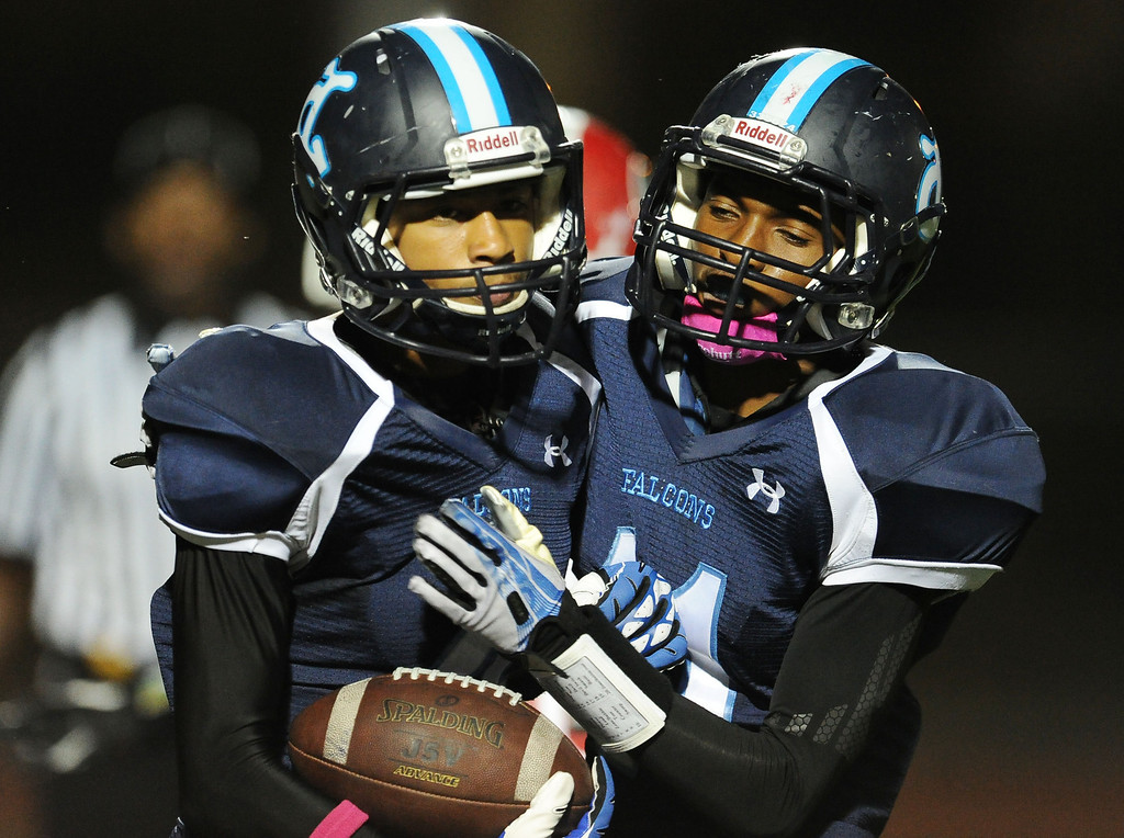 Description of . Duarte's Victor Nureldeen, left, reacts with teammate Devyn Washington (11) after catching a pass for a touchdown against Gladstone in the first half of a prep football game at Duarte High School in Duarte, Calif., Thursday, Oct. 10, 2013.    (Keith Birmingham Pasadena Star-News)