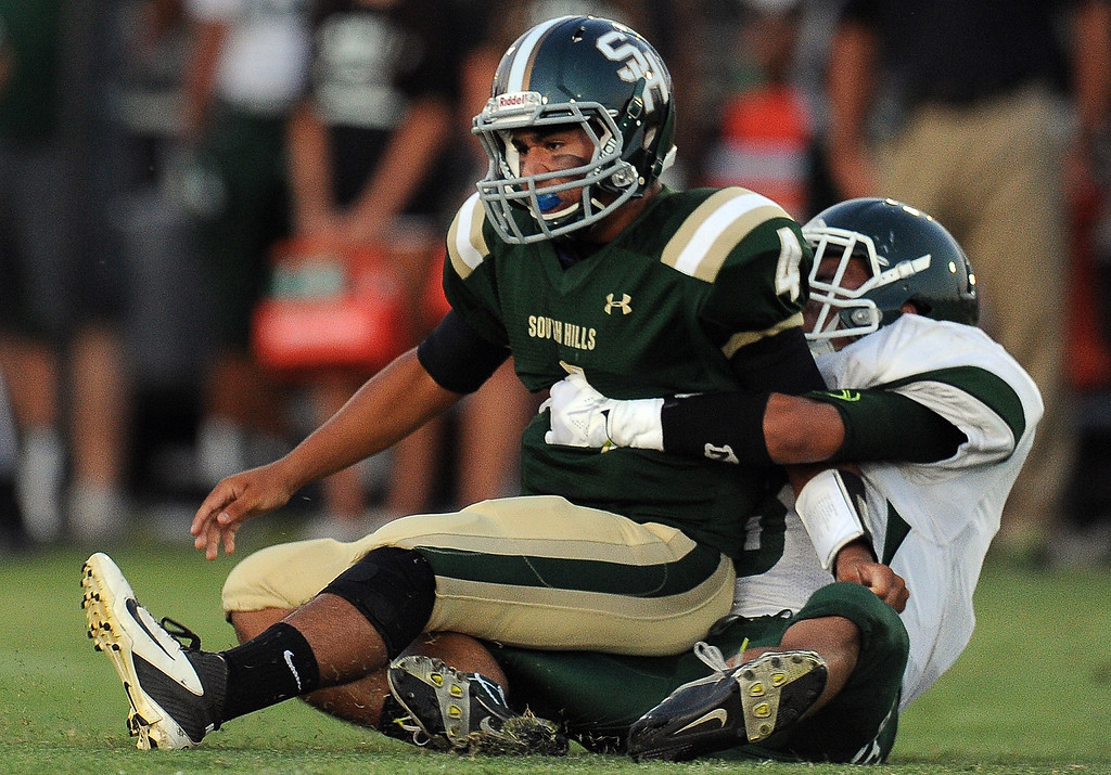 Description of . Bonita's Christian Ramos pressures South Hills quarterback Garrett Fonseca (4) in the first half of a prep football game at Covina District Field in Covina, Calif. on Friday, Sept. 6, 2013.   (Photo by Keith Birmingham/Pasadena Star-News)