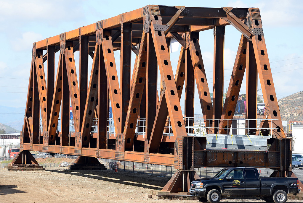 Description of . Work continues on 4 train bridges off the 215 freeway in Grand Terrace Tuesday morning April 1, 2014. The bridges are 200 feet long, 23 feet wide and 30 feet tall and weigh 1.1 million pounds each. The bridges will be moved into a temporary position over the 215 freeway, to replace older bridges, this coming month which will result in a full freeway closure on a number of different days and nights between Iowa Avenue and Barton Road.  (Will Lester/Inland Valley Daily Bulletin)