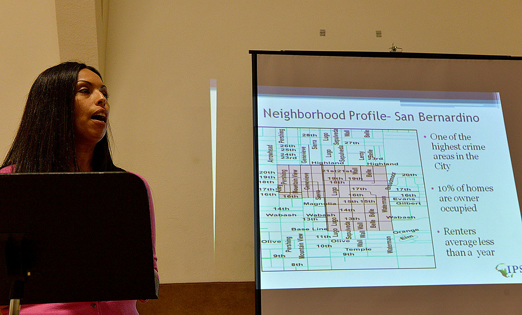 Description of . Sandra Espasdas, from the Institute for Public Strategies, speaks to residents in a high-crime area of San Bernardino about the aim to reduce crime and violence in the area during a meeting Thursday April 3, 2014 in the gym at The Church of Nazarene. Representatives of the IPS Byrne Project, an initiative by the Institute for Public Strategies, will discuss ways that residents can help drive the effort to reclaim the neighborhood. (Staff photo by Rick Sforza/The Sun)