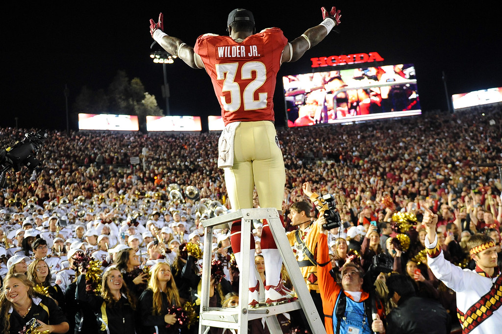 Description of . Florida State's James Wilder Jr. stands atop the drum major ladder following the 2014 Vizio BCS National Championship January 6, 2014 in Pasadena CA.  Florida State won the game 34-31.(Andy Holzman/Los Angeles Daily News)