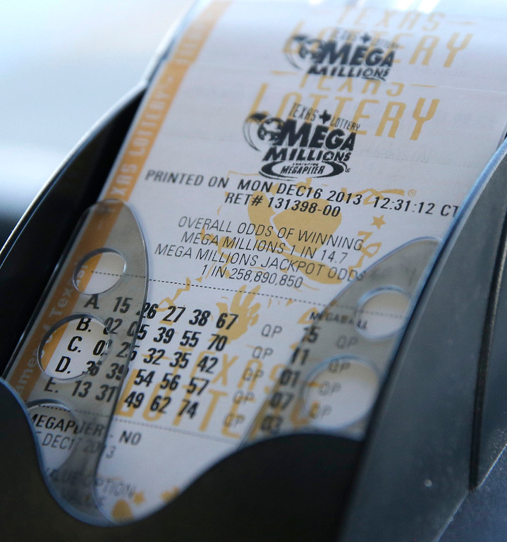 Description of . Mega Millions lottery tickets are printed out at the Fuel City convenience story Monday, Dec. 16, 2013, in Dallas. The Mega Millions jackpot soared to $586 million on Monday amid a frenzy of ticket purchases, a jump that pushed the prize closer to the $656 million U.S. record set last year. (AP Photo/LM Otero)