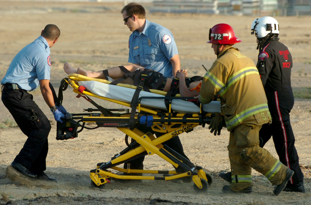 Description of . A 20 year old man rescued by San Bernardino County Firefighters from being crushed by 2000 pounds of granite in a trailer at a contractors business in Fontana April 30, 2013. (Thomas R. Cordova/Staff Photographer)