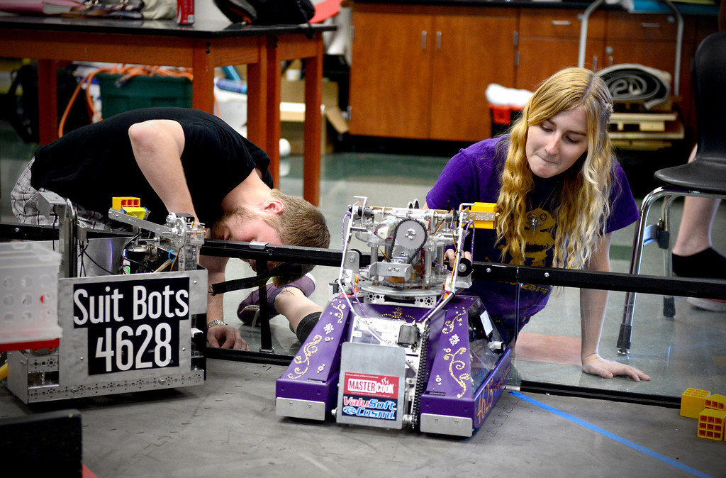 Description of . Melissa Johnson, 16, of The King and Queens, of Monrovia High's Robotics, sets up her team's robot