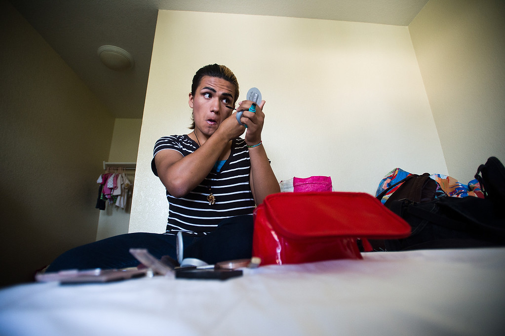 Description of . Patrick Cordova, 15, gets ready for his day at a Motel 6 where his family is living in El Monte, Calif. on Thursday, Sept. 6, 2013. Cordova is a transgender senior at Azusa High who was voted in the top 5 for homecoming queen. (Photo by Watchara Phomicinda/ San Gabriel Valley Tribune)