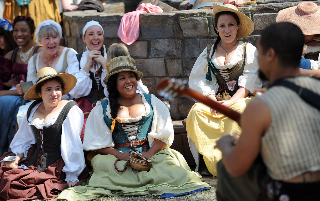 Description of . Performers enjoy opening day of the Renaissance Pleasure Faire at Santa Fe Dam Recreation Area in Irwindale, Calif., on Saturday, April 5, 2014. 