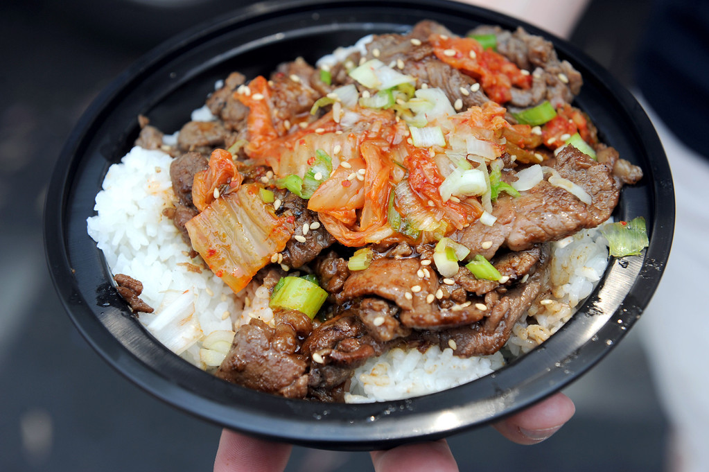 Description of . (John Valenzuela/Staff Photographer) An order of Kalbi, beef marinated Korean Style at the second annual Food Truck and Brewfest in Redlands Saturday, June 29, 2013.