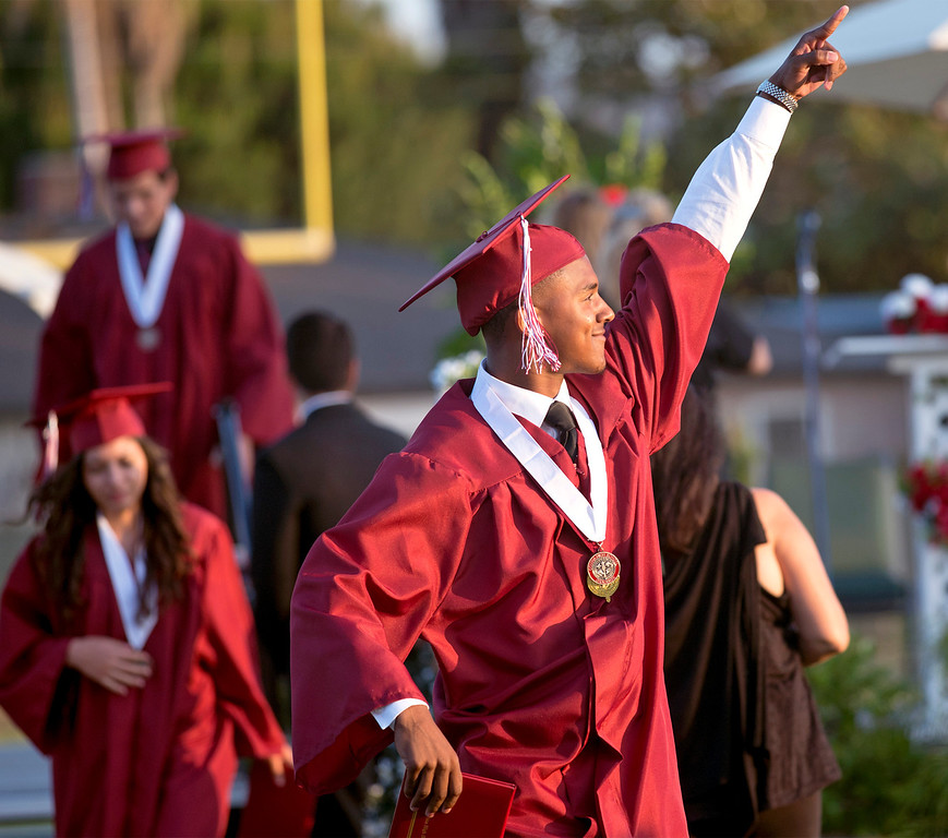 Description of . Covina High School graduation at Covina District Field June 10, 2014.   (Staff photo by Leo Jarzomb/San Gabriel Valley Tribune)