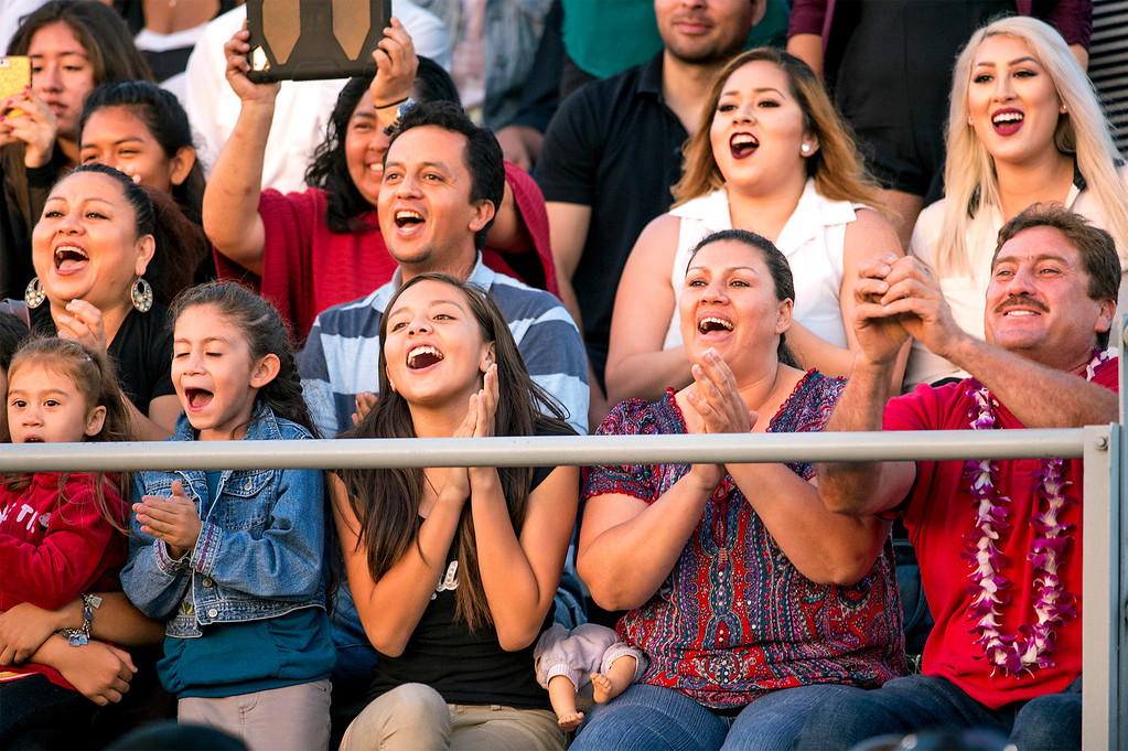 Description of . Families cheer for their grads during the Northview High commencement ceremony at Covina District Field June 11, 2014.   (Staff photo by Leo Jarzomb/San Gabriel Valley Tribune)