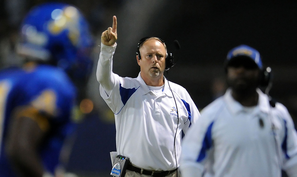 Description of . Bishop Amat head coach Steve Hagerty gives the single going for one after a touchdown against Alemany in the first half of a prep football game at Bishop Amat High School in La Puente, Calif., on Friday, Oct. 25, 2013.    (Keith Birmingham Pasadena Star-News)