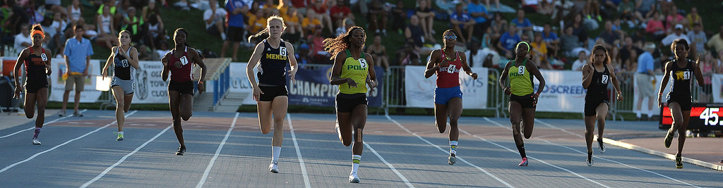 Description of . Long Beach Poly's Kaelin Roberts, center, wins the 400 meter dash during the CIF California State Track & Field Championships at Veteran's Memorial Stadium on the campus of Buchanan High School in Clovis, Calif., on Saturday, June 7, 2014. 