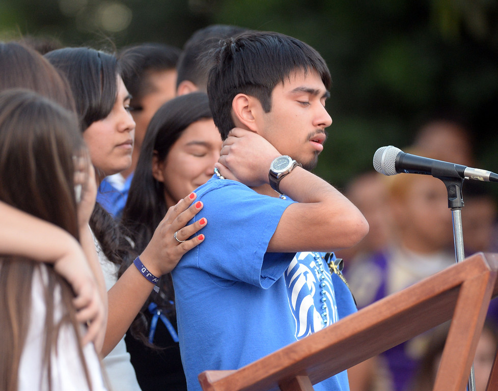 Description of . Christopher Camacho, cousin of Adrian Castro, struggles as he talks about his cousin during a memorial gathering for him at El Monte High School Monday evening April 14, 2014. Castro was one of nine students killed in the bus crash in Orland, Calif. (Staff Photo by Keith Durflinger/San Gabriel Valley Tribune)