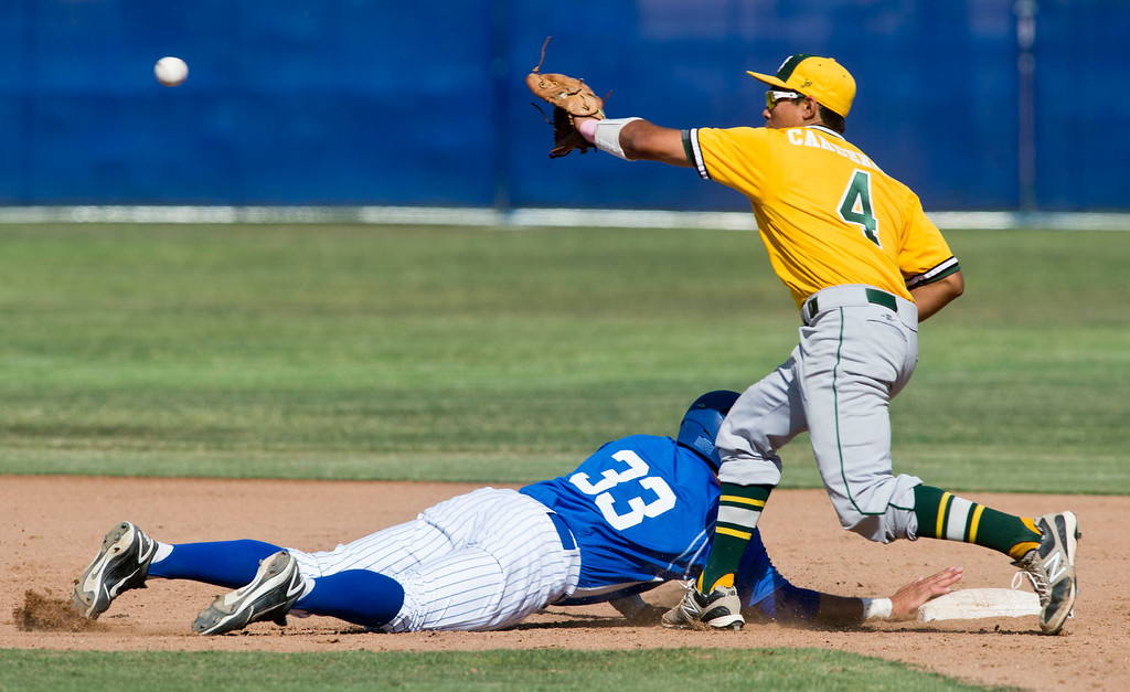 Description of . Amat's Bryan Menendez (#33) slides back to second in the sixth inning during quarterfinal baseball, Mira Costa at Bishop Amat on Friday, May 24, 2013. Mira Costa won 4-2. (SGVN/Staff photo by Watchara Phomicinda)