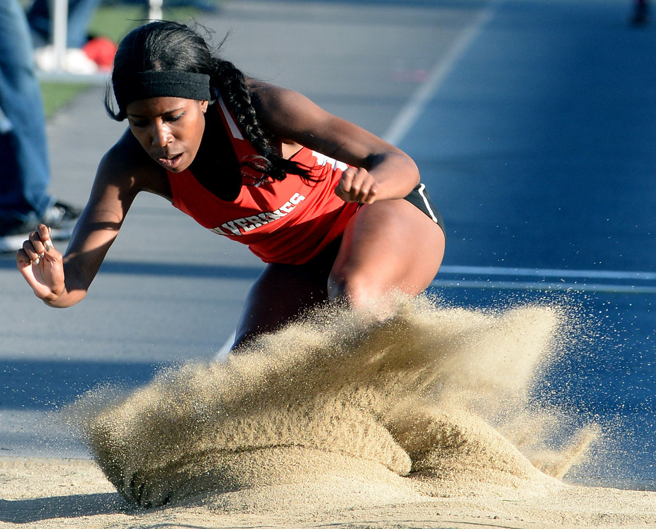 Description of . Harvard Westlake's Efe Agege competes in the Triple Jump during the CIF-SS Masters Track and Field meet at Falcon Field on the campus of Cerritos College in Norwalk, Calif., on Friday, May 30, 2014.   (Keith Birmingham/Pasadena Star-News)