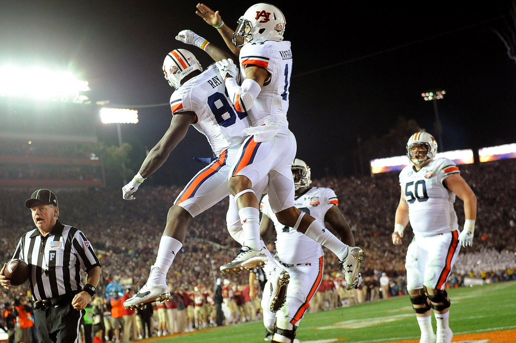 Description of . Auburn's Melvin Ray celebrates his 1st quarter touchdown against Florida State during the 2014 Vizio BCS National Championship January 6, 2014 in Pasadena CA.(Andy Holzman/Los Angeles Daily News)
