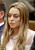 Actress Lindsay Lohan appears at a hearing in Los Angeles Superior Court, Monday, March 18, 2013. Lohan accepted a plea deal on Monday in a misdemeanor car crash case that includes 90 days in a rehabilitation facility. The actress, who has struggled for years with legal problems, pleaded no contest to reckless driving, lying to police and obstructing officers who were investigating the accident involving the actress in June. (AP Photo/Reed Saxon, Pool)