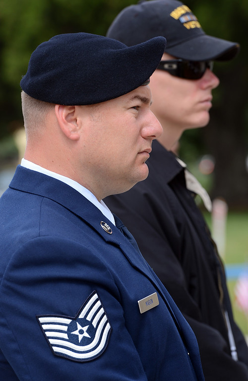 Description of . Jason Mabon, left, an Air Force Reservist and Iraqi War Veteran Dustin Murphy, both University of Redlands students listen to speakers during a memorial service for fallen service members was held Friday May 17, 2013 in front of the Memorial Chapel at the university. The ceremony featured a special tribute to Keith Taylor, a University of Redlands alumnus and father of a University of Redlands student. He was killed serving in Iraq. (Rick Sforza/Staff photographer, Redlands Daily Facts)