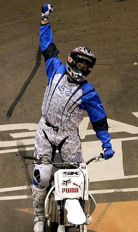 Description of . The 10th X Games at the Staples Center in Los Angeles Thursday August 5,2004. Chuck Carothers of Kingwood, Teaxas win the gold with a score of 93:20 in the Moto X Best Trick. Carothers celebrates after his winning jump.(Pasadena Star-News Staff Photo Keith Birmingham/SXSports)