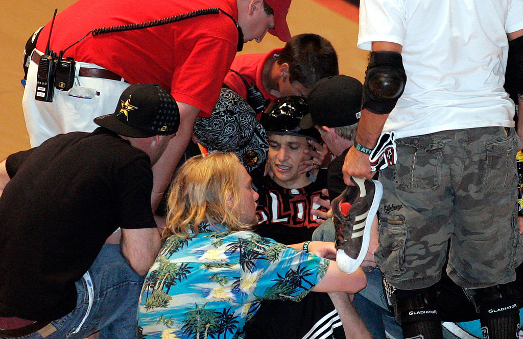 Description of . Jake Brown is tended to by medical personnel after taking a 50-foot plunge into the skateboarding abyss after completing the very elusive 720 degree spin during X Games 13 at Staples Center in Los Angeles California on August 2, 2007.  (SGVN/Staff Photo by Raul Roa/Sports)