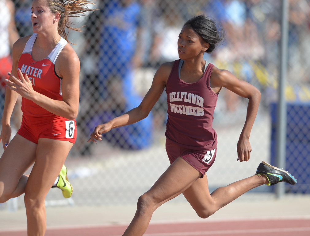 Description of . Bellflower's Janaya Shorty takes the turn to win the 200 meter Division 3 race of the CIF Southern Section Track and Field Championships Saturday at Mt. SAC. 20130518 Photo by Steve McCrank / Staff Photographer