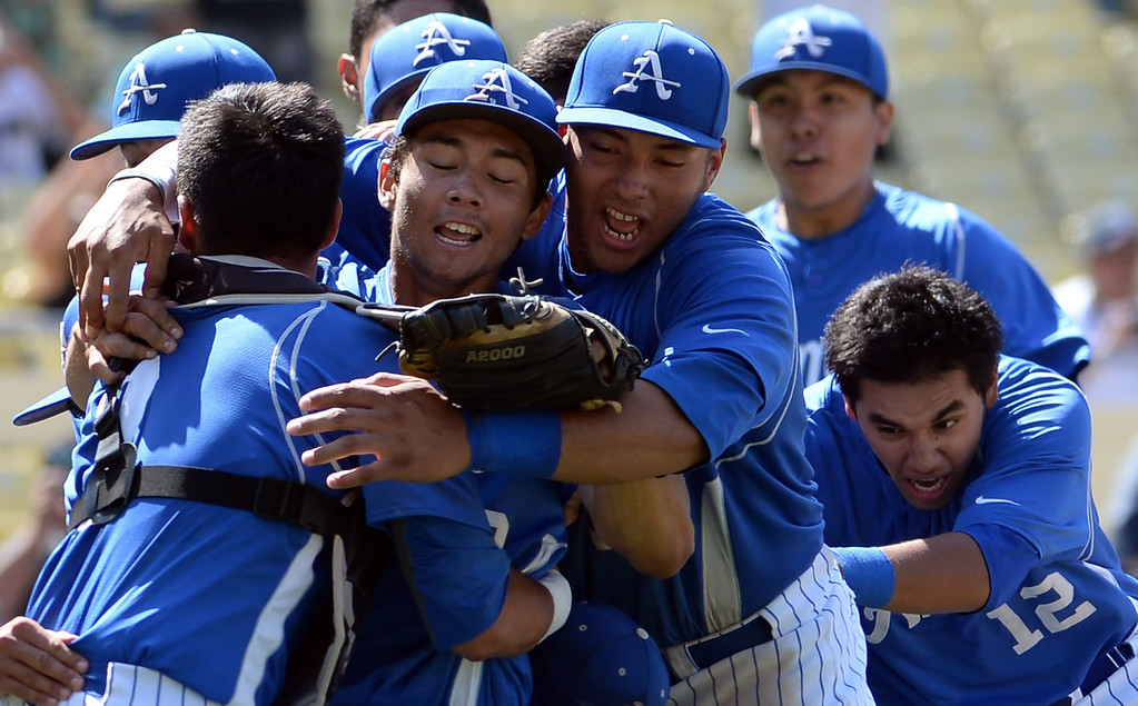 Description of . Bishop Amat pitcher Scott Hurst, center, is mobbed by teammates after recording the final out and defeating Palm Desert 4-3 to win the CIF-SS Division 3 baseball championship at Dodger Stadium in Los Angeles on Friday, June 6, 2014.   (Keith Birmingham/Pasadena Star-News)