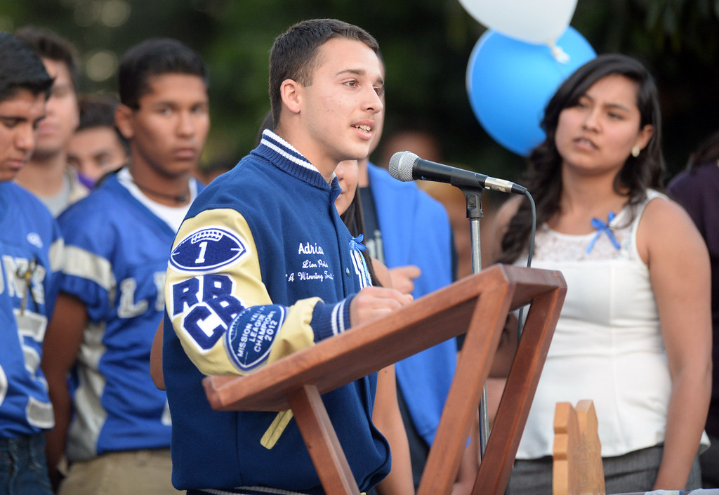 Description of . Roman Castro, 16, speaks about his brother, Adrian Castro, 19, during a memorial gathering at El Monte High School Monday evening April 14, 2014. Castro was one of nine students killed in the bus crash in Orland, Calif. (Staff Photo by Keith Durflinger/San Gabriel Valley Tribune)