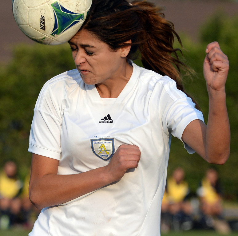 Description of . Bishop Amat's Nicolette Martinez goes-up for the header against Marshall in the first half of a prep soccer match at Bishop Amat High School in La Puente, Calif., on Thursday, Jan. 9, 2014. (Keith Birmingham Pasadena Star-News)
