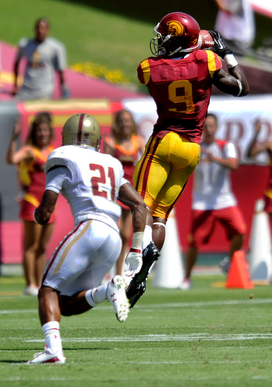 Description of . USC #9 Marqise Lee pulls in a reception against Boston #21Manuel Asprilla,  and converted it for an 80 yard touchdown in the second quarter. USC Played Boston College at the Coliseum in Los Angeles, CA. 9/14/2013. photo by (John McCoy/Los Angeles Daily News)