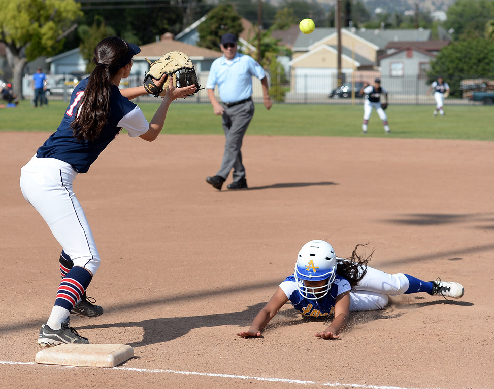 Description of . St. Paul plays Bishop Amat in their Del Rey League girls softball game at York Field in Whittier on Thursday March 27, 2014. St. Paul defeated Bishop Amat 7-5. (Staff Photo by Keith Durflinger/Whittier Daily News)