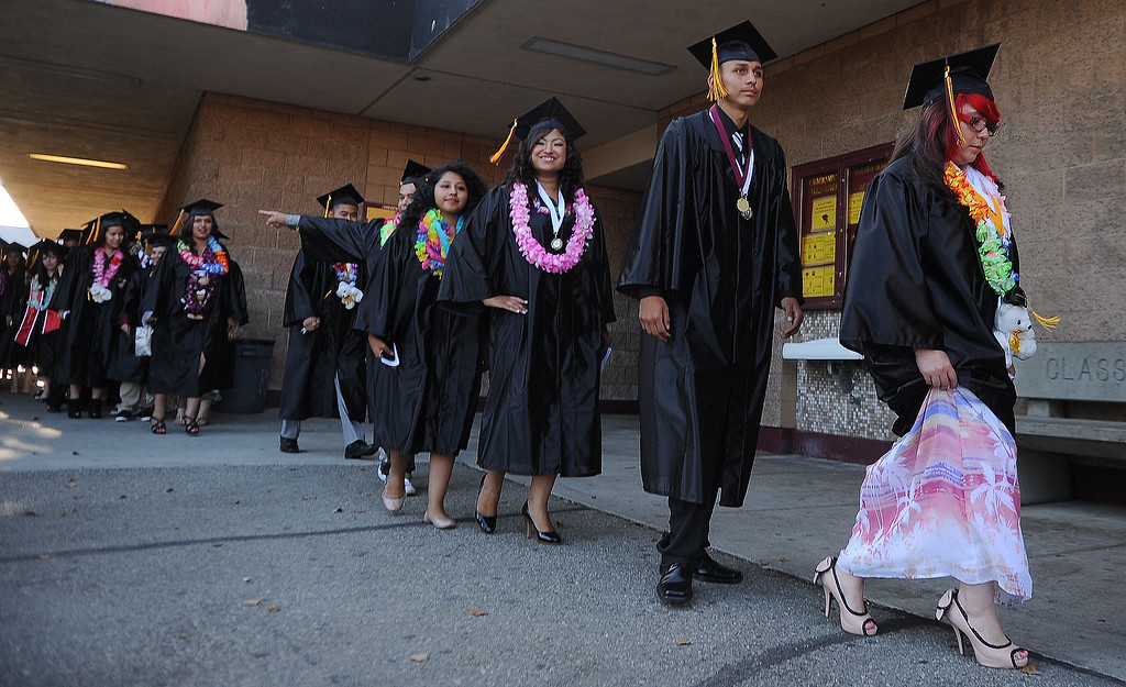 Description of . Students walk to their seats during the processional during the Vail High School commencement at Vail High School on Tuesday, June 18, 2013 in Montebello, Calif.