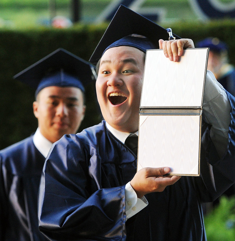 Description of . Vincent La shows his diploma after graduation ceremonies. Gabrielino High in San Gabriel School Class of 2014 graduation was held at Santa Anita Park in Arcadia Wednesday, June 4, 2014.Photo by Walt Mancini/Pasadena Star-News)